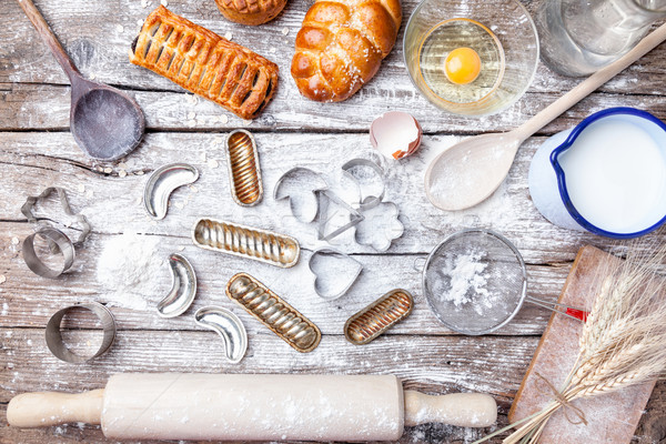 Delicious holiday baking background with ingredients and utensils Stock photo © tommyandone