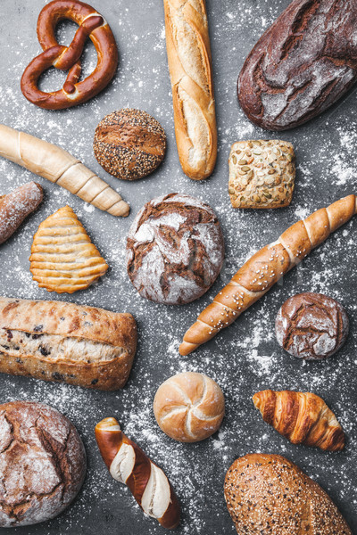 Delicious fresh bread on rustic background Stock photo © tommyandone
