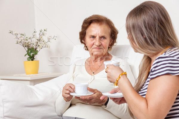 Gondozó csésze tea idős nő idős nyugdíjas Stock fotó © tommyandone