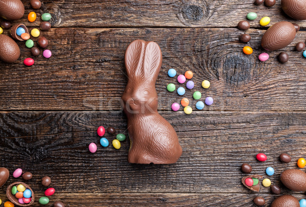 Chocolate Easter bunny, eggs and sweets on rustic background Stock photo © tommyandone