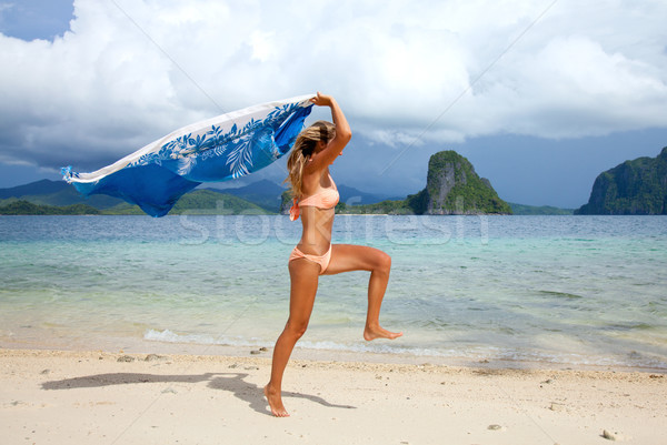 Stock photo: Beautiful young woman jumping