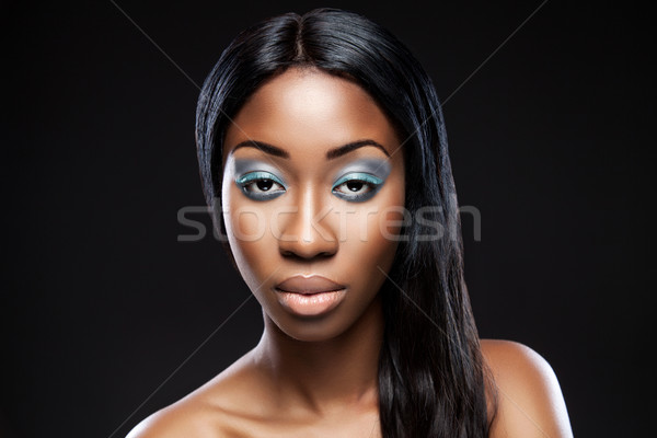 Beautiful young black woman with makeup Stock photo © tommyandone