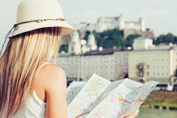 Female tourist on vacation in Salzburg Austria holding a local map Stock photo © tommyandone