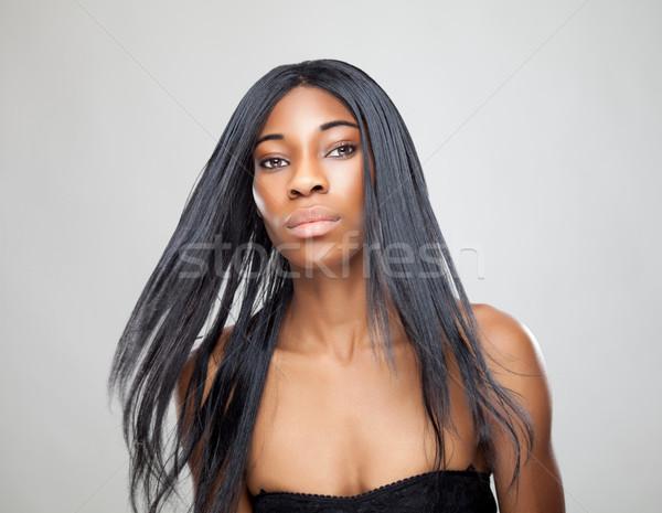 Zwarte schoonheid lang steil haar mooie vrouw vrouw Stockfoto © tommyandone