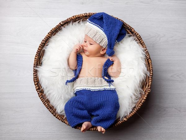 Stock photo: Beautiful newborn inside a basket