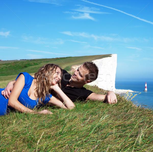 счастливым пару край утес улыбаясь белый Сток-фото © tommyandone