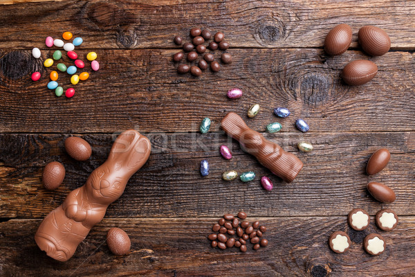Chocolate Easter bunny and eggs on wooden background Stock photo © tommyandone