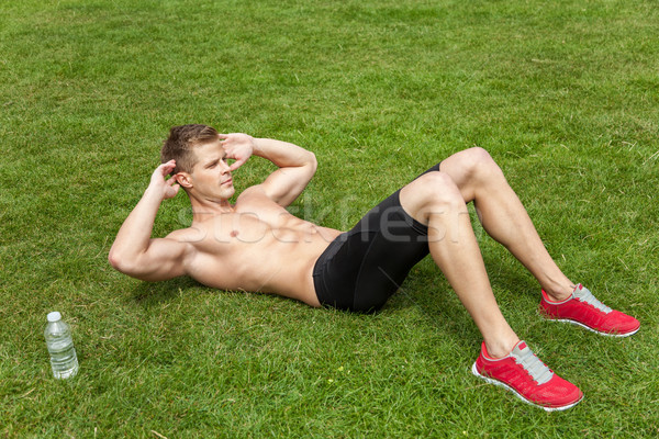 Outdoor abs excercise Stock photo © tommyandone