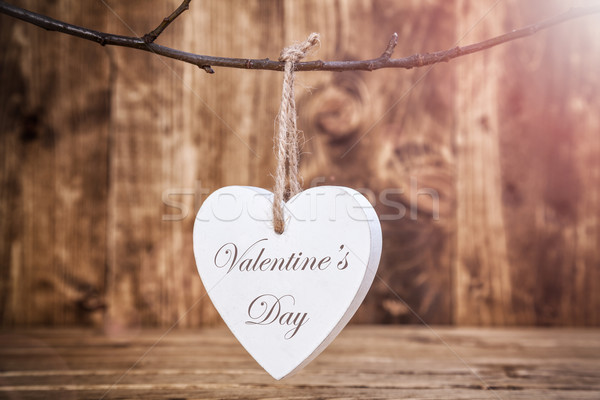 Love concept. Heart hanging on a string Stock photo © tommyandone