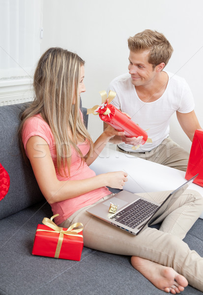 Happy couple exchanging gifts  Stock photo © tommyandone