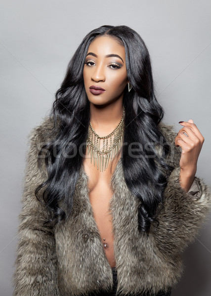 Beautiful black woman with long curly hair Stock photo © tommyandone