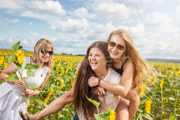 Stock photo: Three friends having a good time outdoors