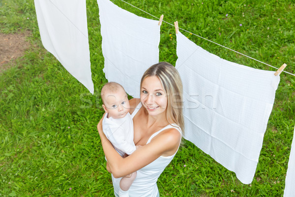 Stock photo: Beautiful mother and baby playing together outdoors