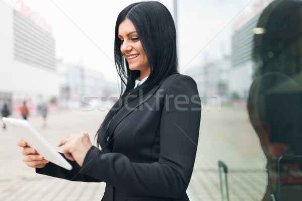Successful business woman working with tablet in an urban setting Stock photo © tommyandone
