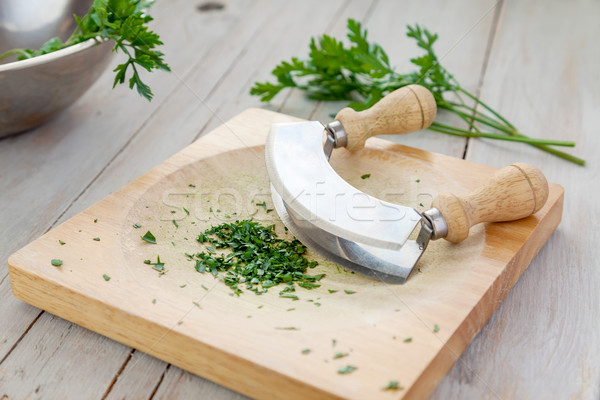 Fresh parsley on a board with mezzaluna  Stock photo © tommyandone