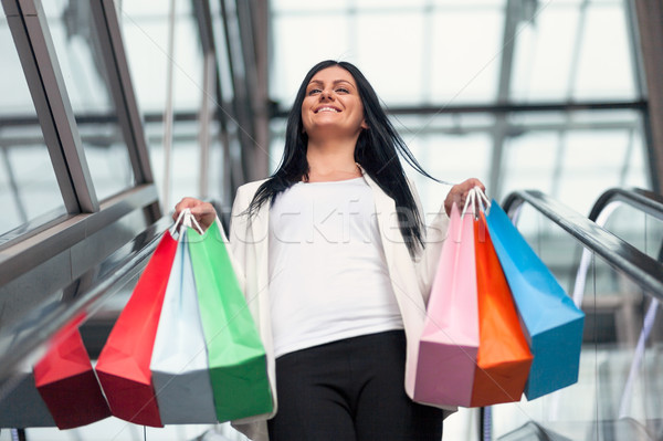Beautiful woman leaving the mall with plenty of shopping bags Stock photo © tommyandone