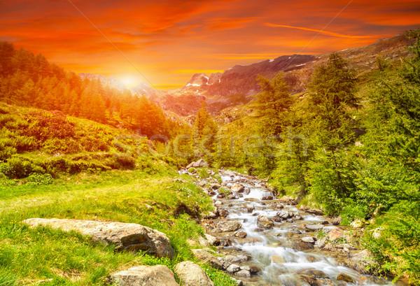 Coloré coucher du soleil rivière alpes alpine Photo stock © tommyandone