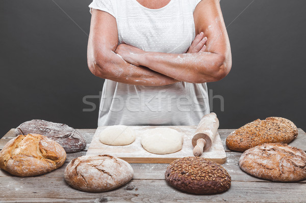 Baker preparing delicious fresh bread and pastry Stock photo © tommyandone
