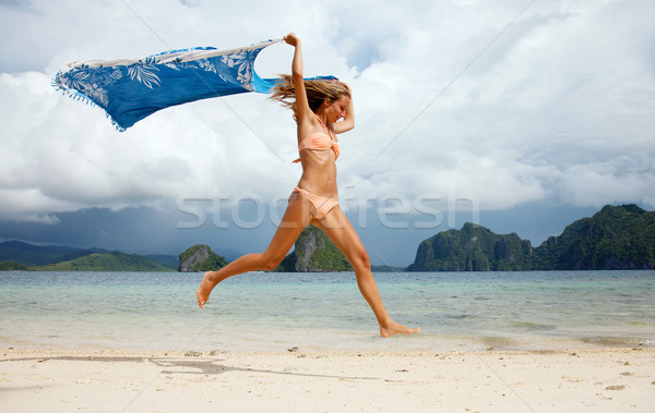Beautiful young woman jumping Stock photo © tommyandone