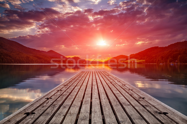 Beautiful sunset view from a wooden platform Stock photo © tommyandone