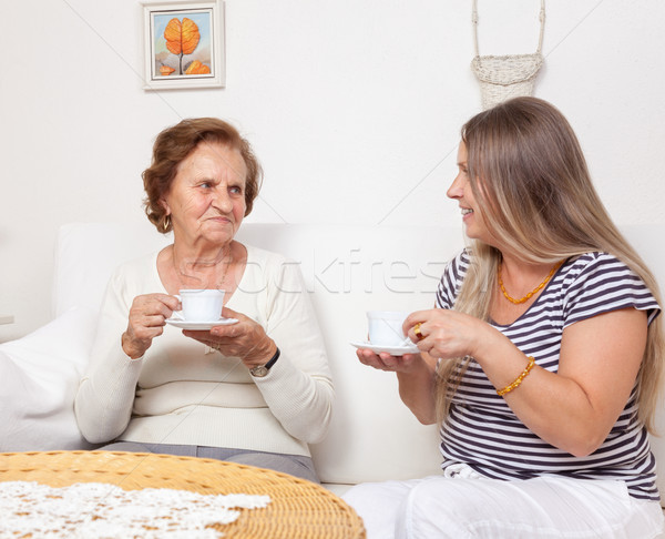 Carer having a cup of tea with an elderly woman Stock photo © tommyandone
