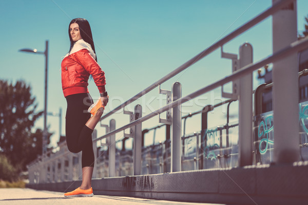 City workout. Beautiful woman training in an urban setting Stock photo © tommyandone