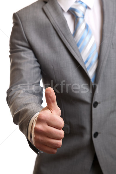 Businessman giving thumbs-up Stock photo © tommyandone