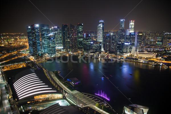 Singapour affaires centre nuit gratte-ciel eau Photo stock © tommyandone