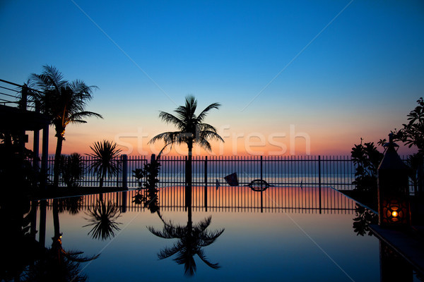 Sunset and infinity pool Stock photo © tommyandone