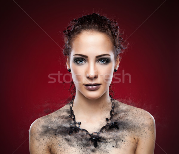 Woman's dark necklace expodes into pieces Stock photo © tommyandone