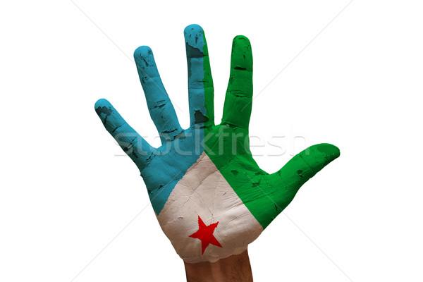 Dłoni banderą Dżibuti człowiek strony malowany Zdjęcia stock © tony4urban