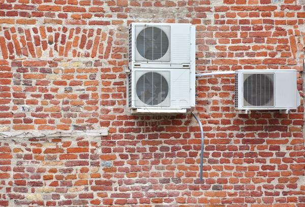 空調装置 戻る 家 レンガの壁 電気 ストックフォト © tony4urban