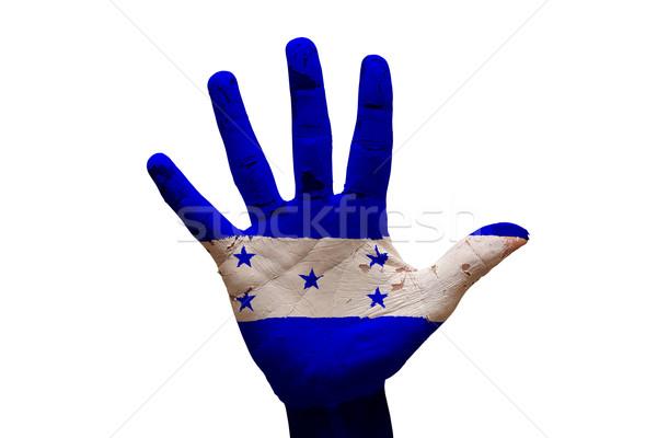 Palm bandiera Honduras uomo mano verniciato Foto d'archivio © tony4urban