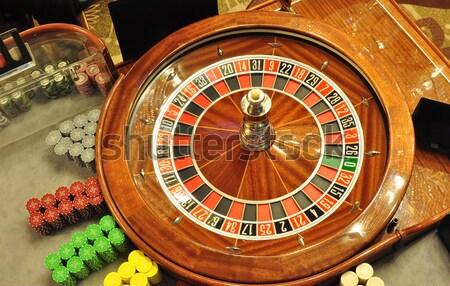 Rueda de la ruleta casino chips dinero diversión Foto stock © tony4urban