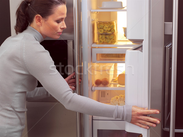 woman in front of the fridge aa Stock photo © toocan