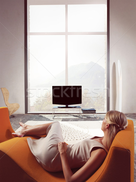 Blond woman watching TV Stock photo © toocan