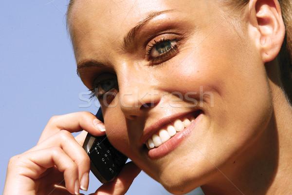 Donna parlando cellulare bella donna guardando copia spazio Foto d'archivio © toocan