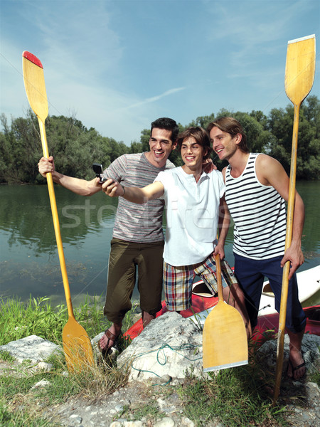 men with canoe in nature Stock photo © toocan
