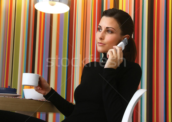 Woman with Coffee and Cell Phone Stock photo © toocan