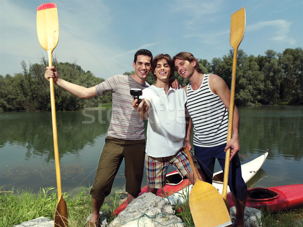men with canoe in nature io Stock photo © toocan