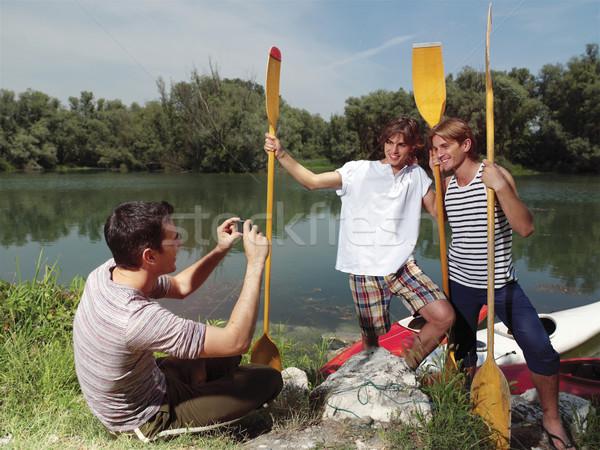 friends having fun at sunday near river Stock photo © toocan
