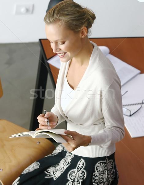 Mutlu öğretmen oturma tablo dokunmak kitaplar Stok fotoğraf © toocan