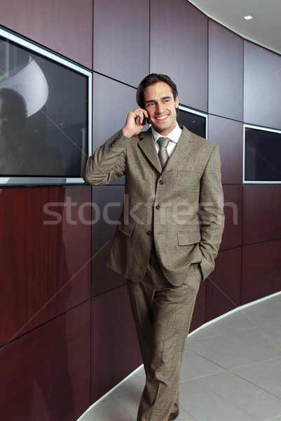 Businessman with mobile phone h Stock photo © toocan