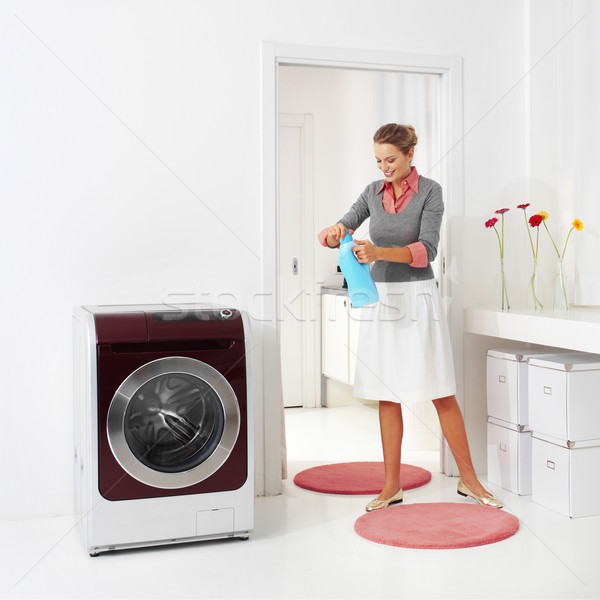 woman doing a housework holding presoak  Stock photo © toocan