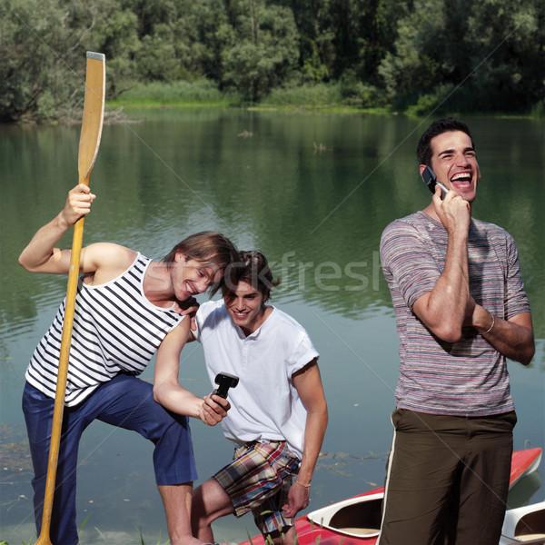 Boldog férfiak kenu természet férfi tenger Stock fotó © toocan