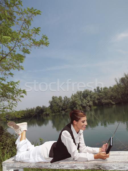 Kadın dizüstü bilgisayar park kız telefon ahşap Stok fotoğraf © toocan