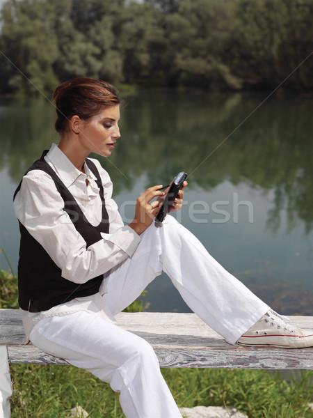 Nő laptop park lány telefon fák Stock fotó © toocan