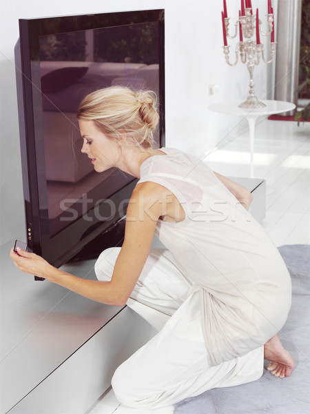 Bella donna seduta tv collegare Foto d'archivio © toocan