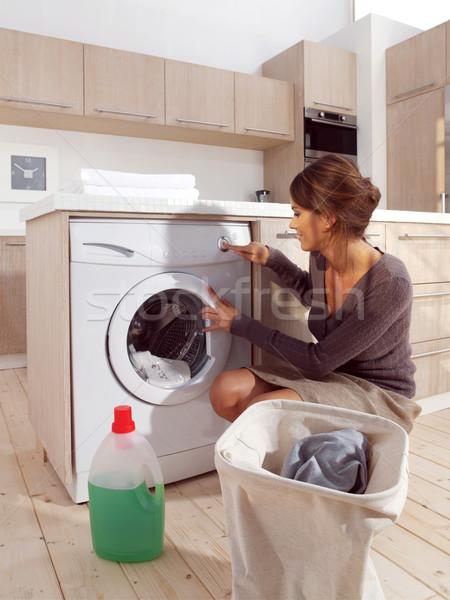 woman loading the washing machine Stock photo © toocan