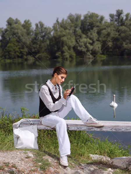 woman using PDA outdoors Stock photo © toocan